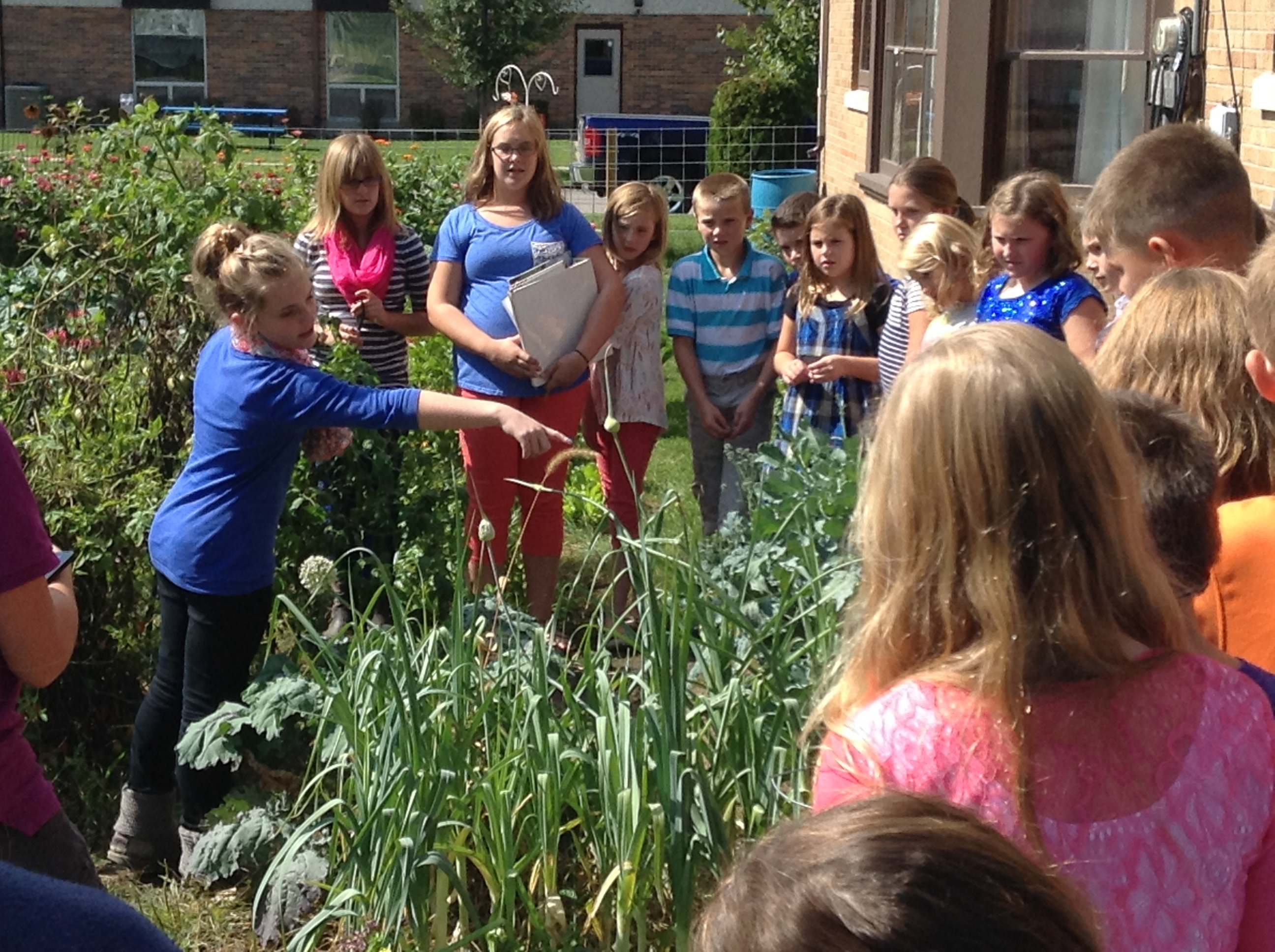 student leaders in garden identifying plants